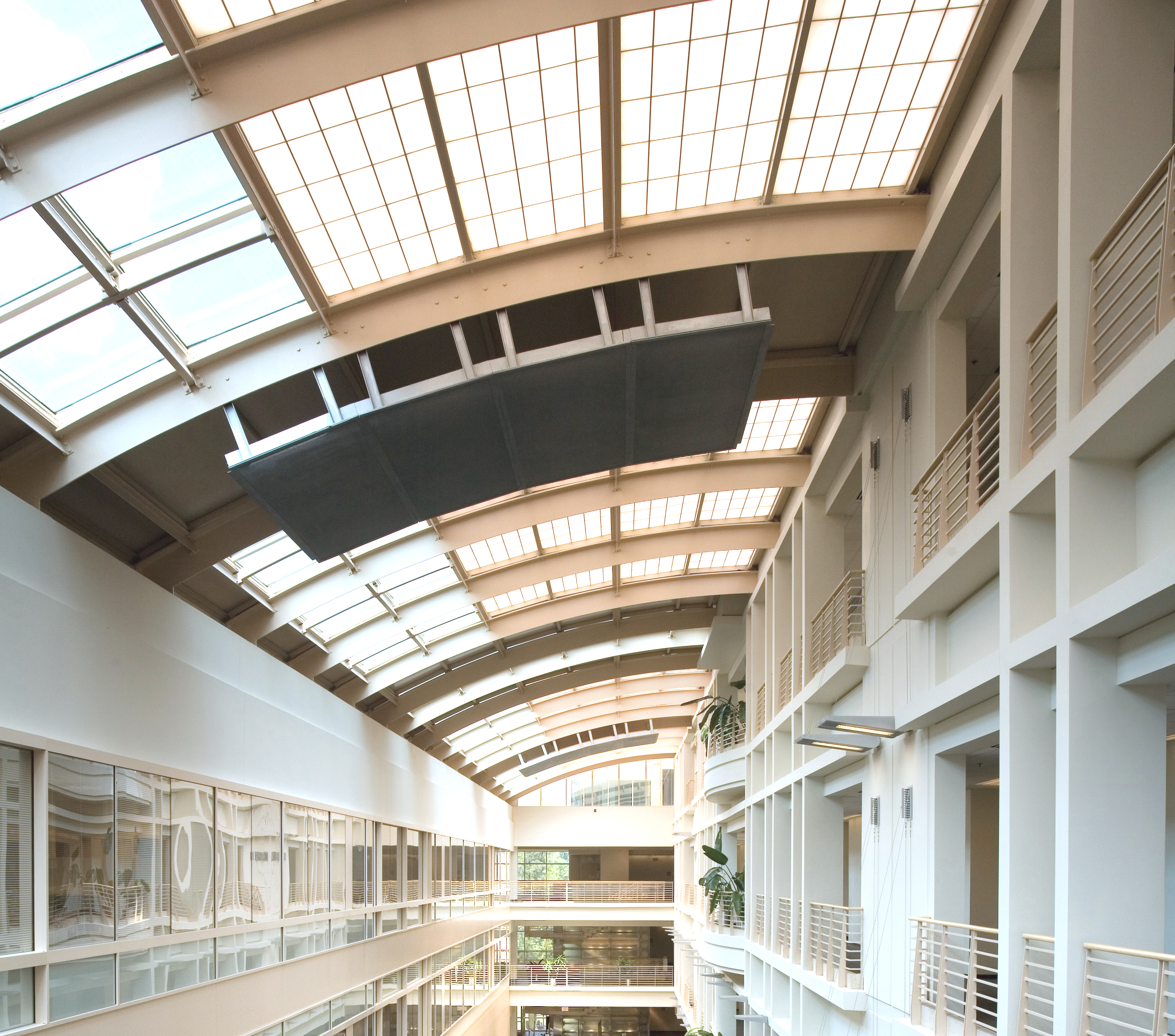 Skylights and balconies inside a bright building at the EPA in RTP