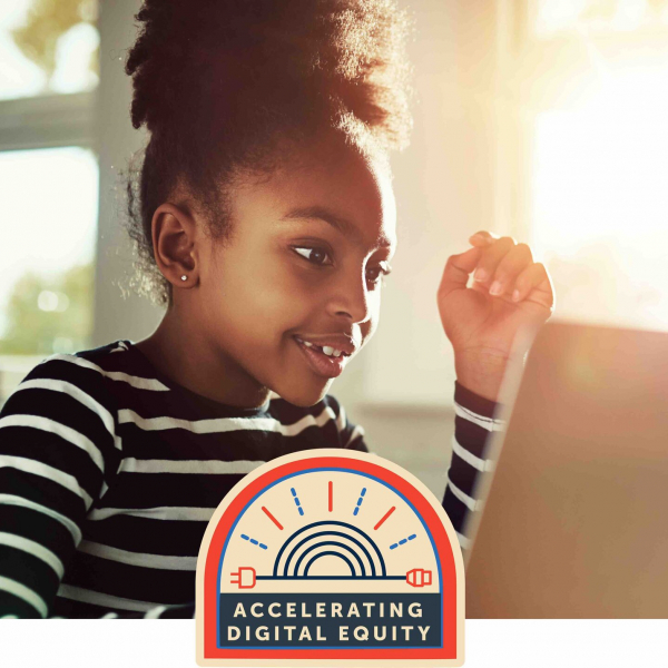 Girl working on laptop with Accelerating digital equity logo