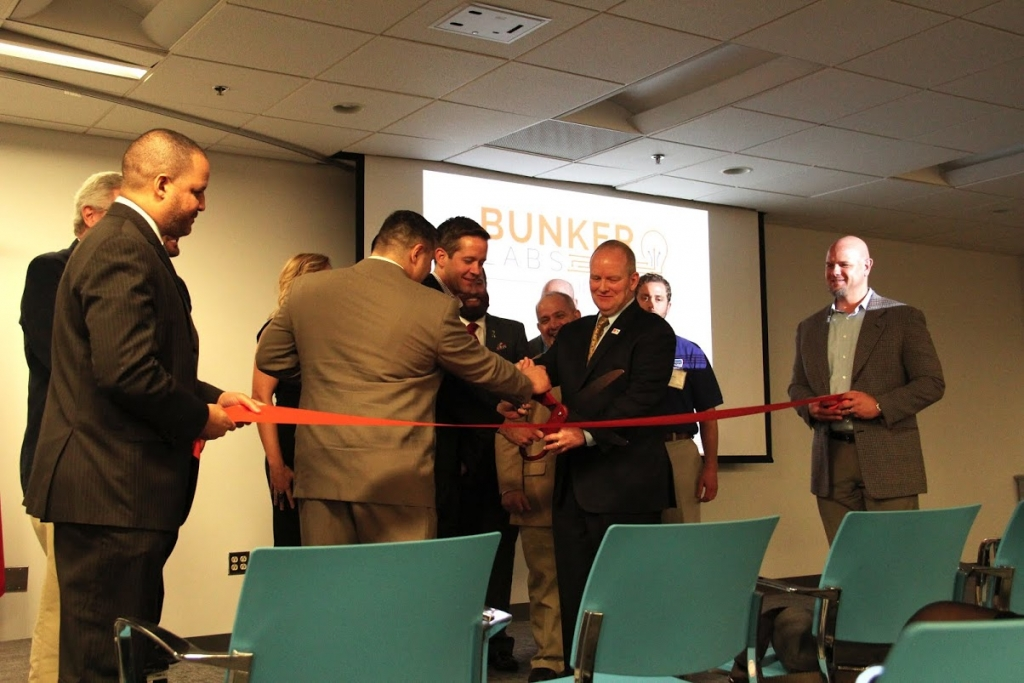 Dean Bundschu, Todd Connor, and Colonel David W. Sutherland cut the ceremonial ribbon to launch Bunker Labs RDU