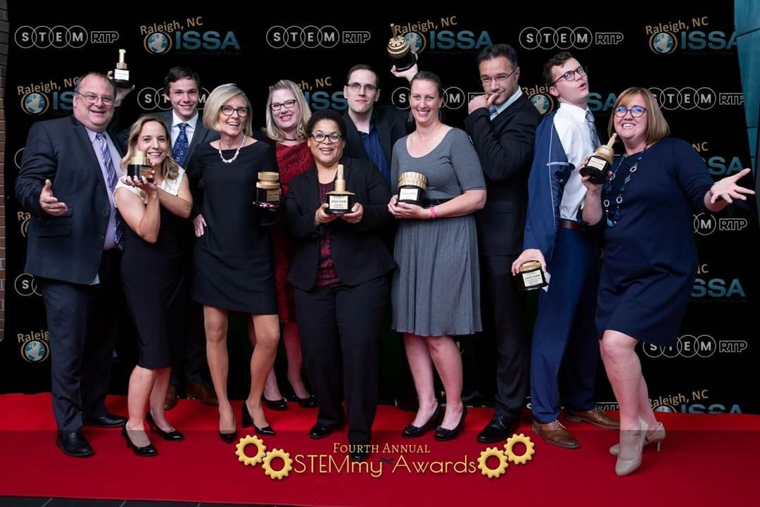 STEMmy award winners pose with their awards