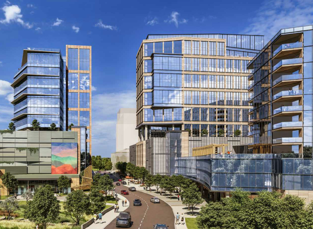 Rendering of the new high rise office building coming to Hub RTP. The buildings glass are reflecting a sunny sky and are surrounded by greenspace and trees.